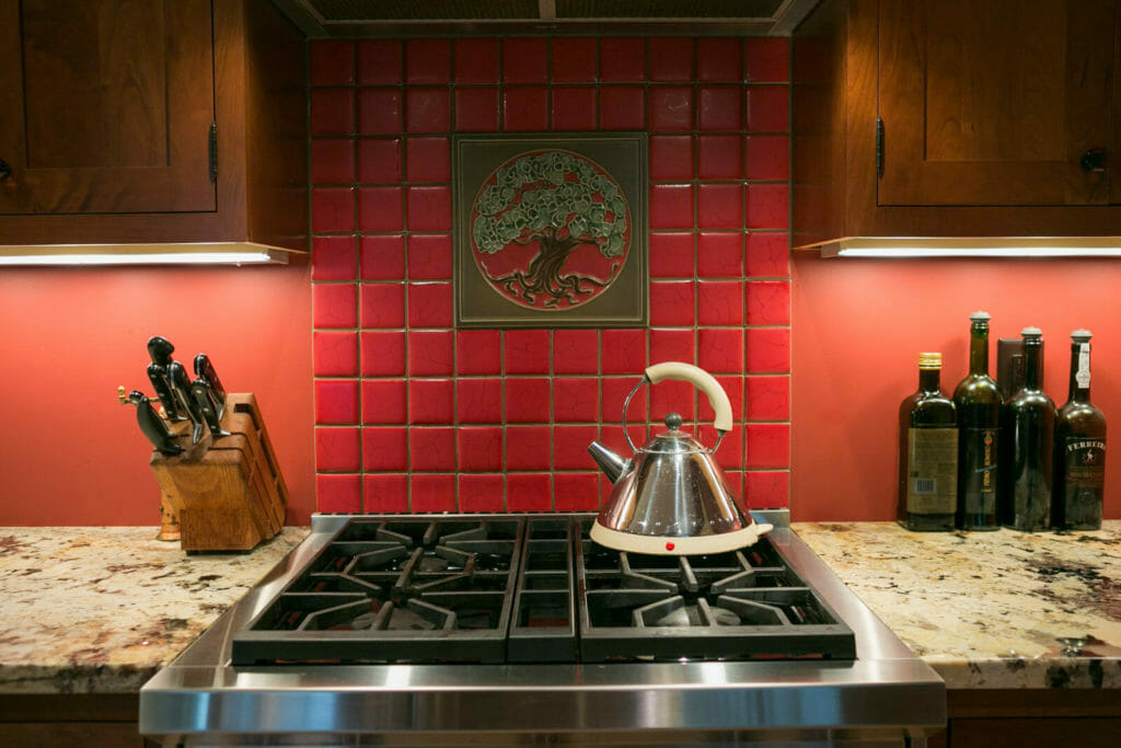 Motawi decorative tile and granite countertops in the kitchen of the historic restoration of a 1922 Frank Riley Colonial Revival home on the Isthmus in Madison, Wisconsin.