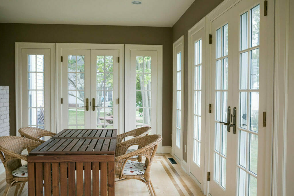 Interior of the recreated sun porch from an old photo for the historic renovation of a 1922 Frank Riley Colonial Revival home on the Isthmus in Madison, Wisconsin.