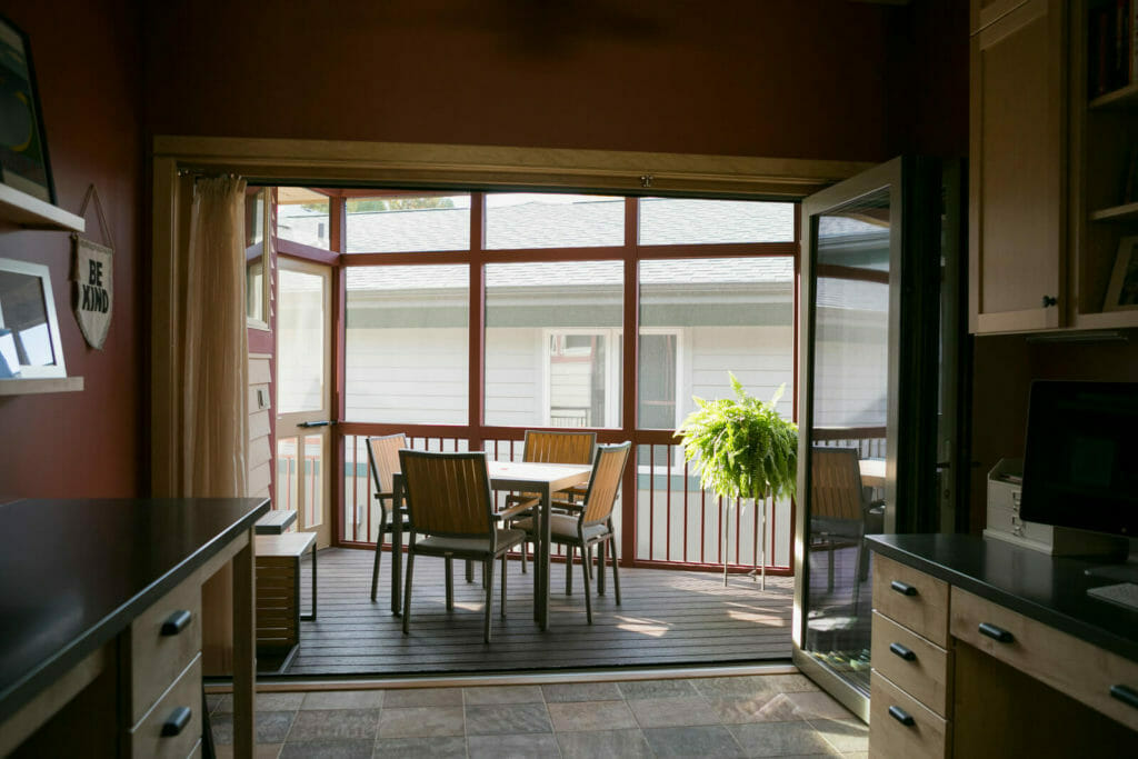 An addition of a screen porch with a full-length accordion door that opens up the family craft room in Middleton, WI by TDS Custom Construction.