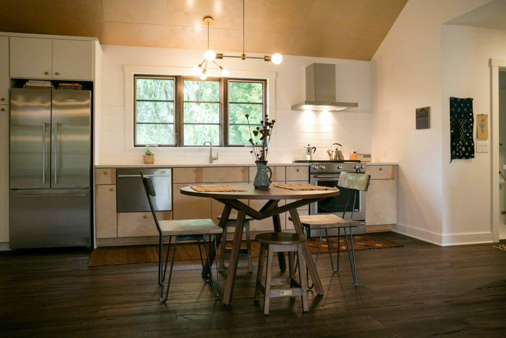Lofted plywood ceilings, birch cabinets, stainless steel appliances and an open floor plan were part of the new kitchen in this whole house remodel in Monona, Wisconsin by TDS Custom Construction.