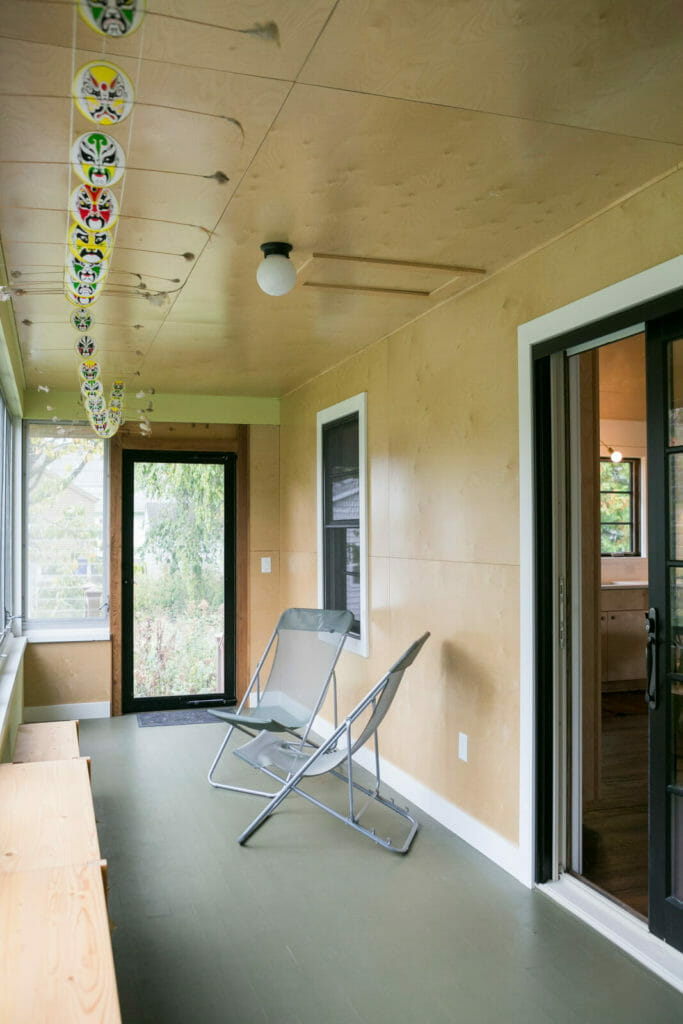 Plywood ceilings and walls were part of this modern entryway for a whole house remodel in Monona, Wisconsin by TDS Custom Construction.