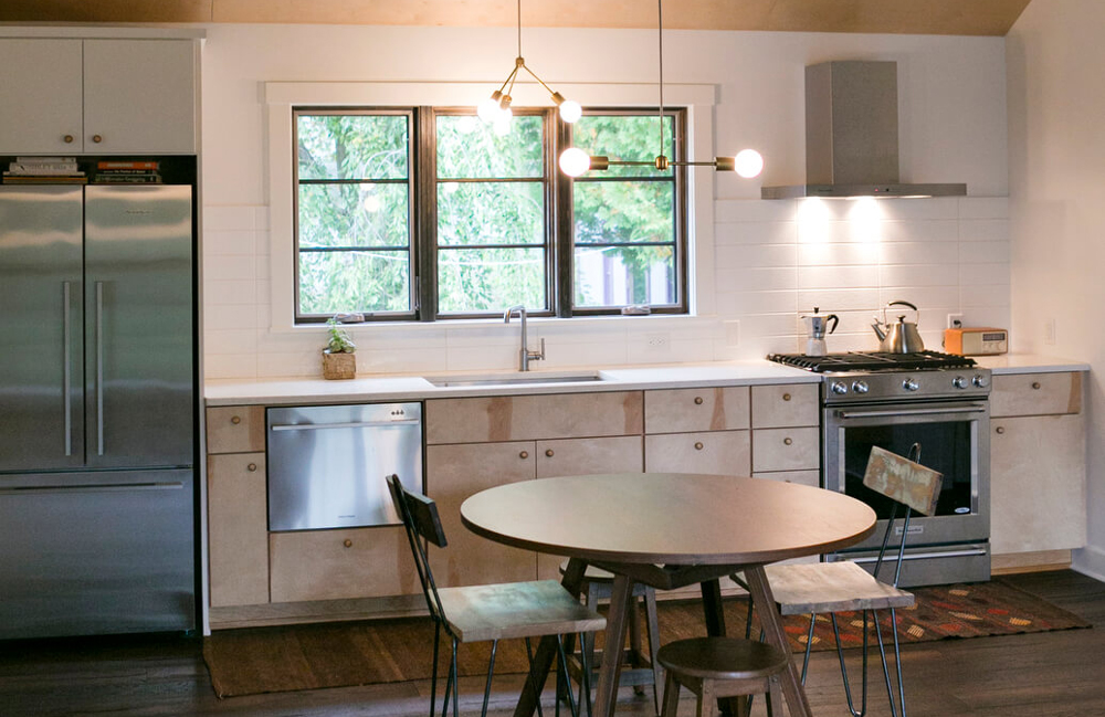 Lofted plywood ceilings, birch cabinets, stainless steel appliances and an open floor plan were part of the the kitchen in this whole house remodel in Monona, Wisconsin by TDS Custom Construction.