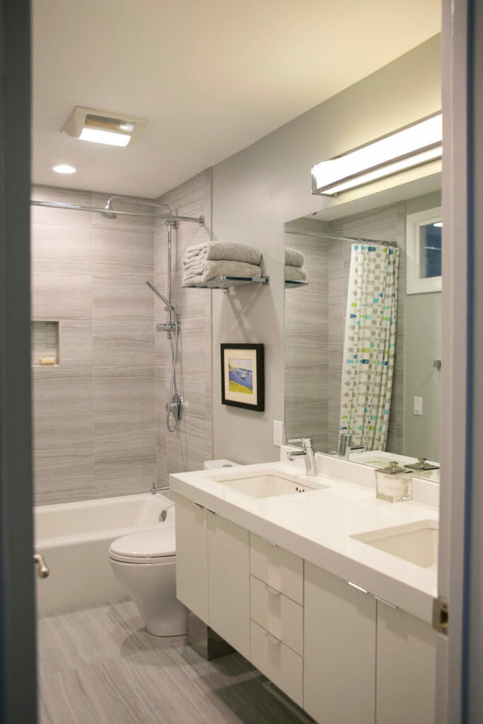 Custom kids bathroom remodel with quartz countertops and Woodharbor cabinets in Maple Bluff, Wisconsin by TDS Custom Construction.