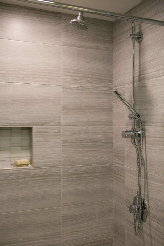 Custom kids bathroom remodel with tiled shower in Maple Bluff, Wisconsin by TDS Custom Construction.