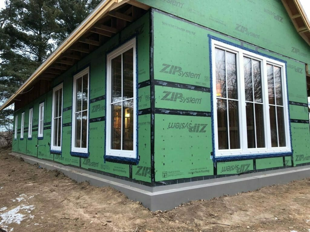 Windows and doors from Kneer-Sud are installed and taped and sealed to the ZIP sheathing to maintain the air barrier.