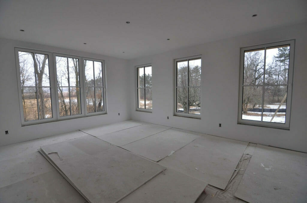 Drywall installed at the walls and ceiling in a passive house built by TDS Custom Construction in McFarland, Wisconsin