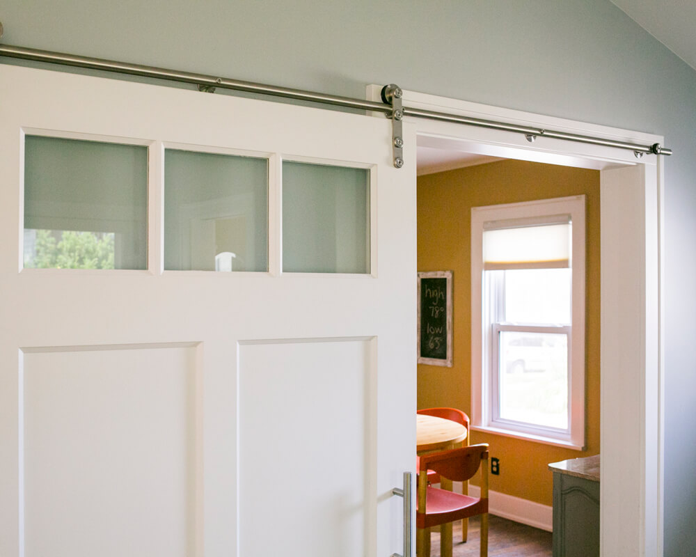 Modern barn door added to this family room addition on the East Side of Madison, designed and built by TDS Custom Construction.