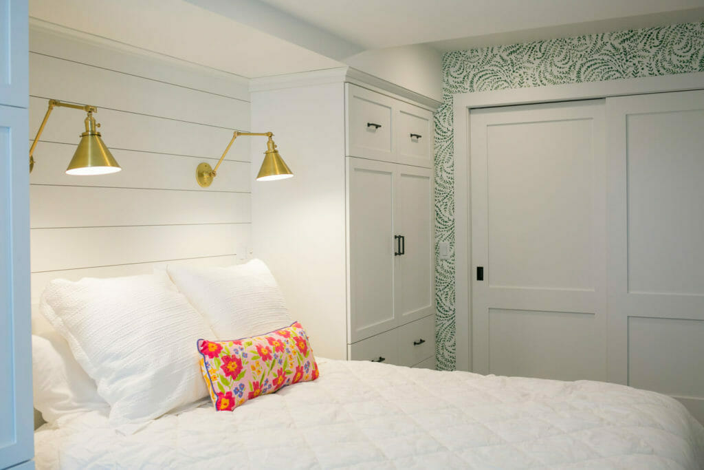 Lower level remodel that includes a guest suite with many beautiful details: wallpaper, brass reading lights, and custom cabinets. By TDS Custom Construction of Madison, Wisconsin.