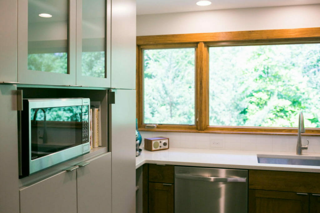 Simple kitchen remodel with Woodharbor walnut lower cabinets and painted upper cabinets installed in a near-west Madison Wisconsin kitchen remodel by TDS Custom Construction.