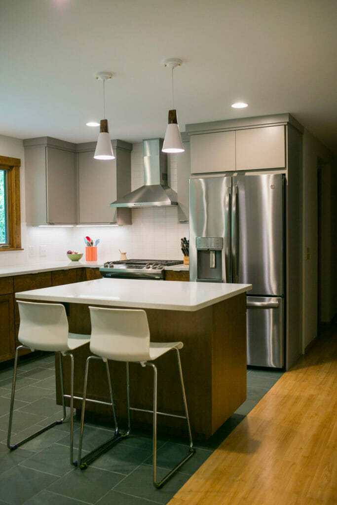 Contemporary near-west Madison kitchen remodel with pendant lights, WoodHarbor cabinets, and quartz countertops, designed and built by TDS Custom Construction.