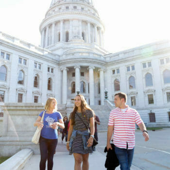 Guide and Food and Drink group tour walking down Capital steps in Madison, Wisconsin