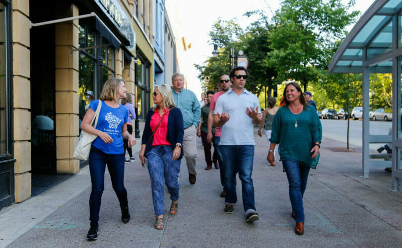 Food and drink group tour walking in downtown Madison, Wisconsin
