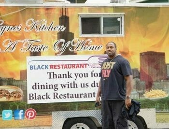 Owner standing in front of Haynes Kitchen food cart