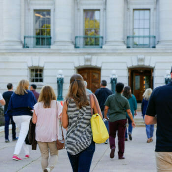 Food and Drink tour guests walking towards Capital entrance in Madison, Wisconsin