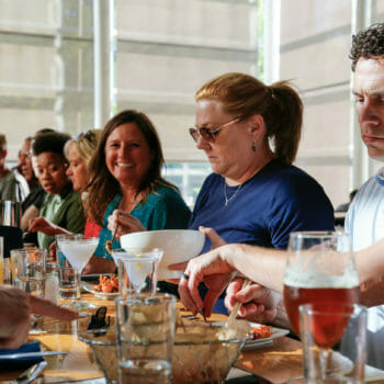 Food and Drink tour group dining at long table