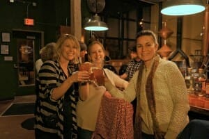 Guests toasting glasses at stop on food and drink tour
