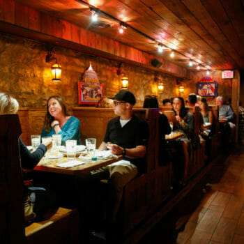 Restaurant patrons dining at booth