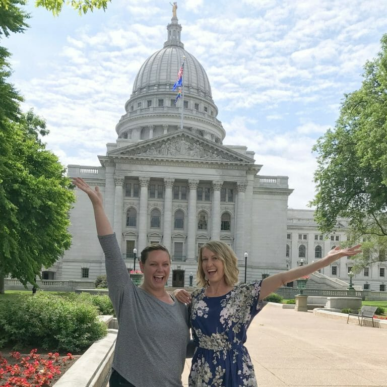 Otehlia Cassidy, owner of Madison Eats Food Tours, stands in front of the State Capitol building after purchasing Capital City Food Tours.