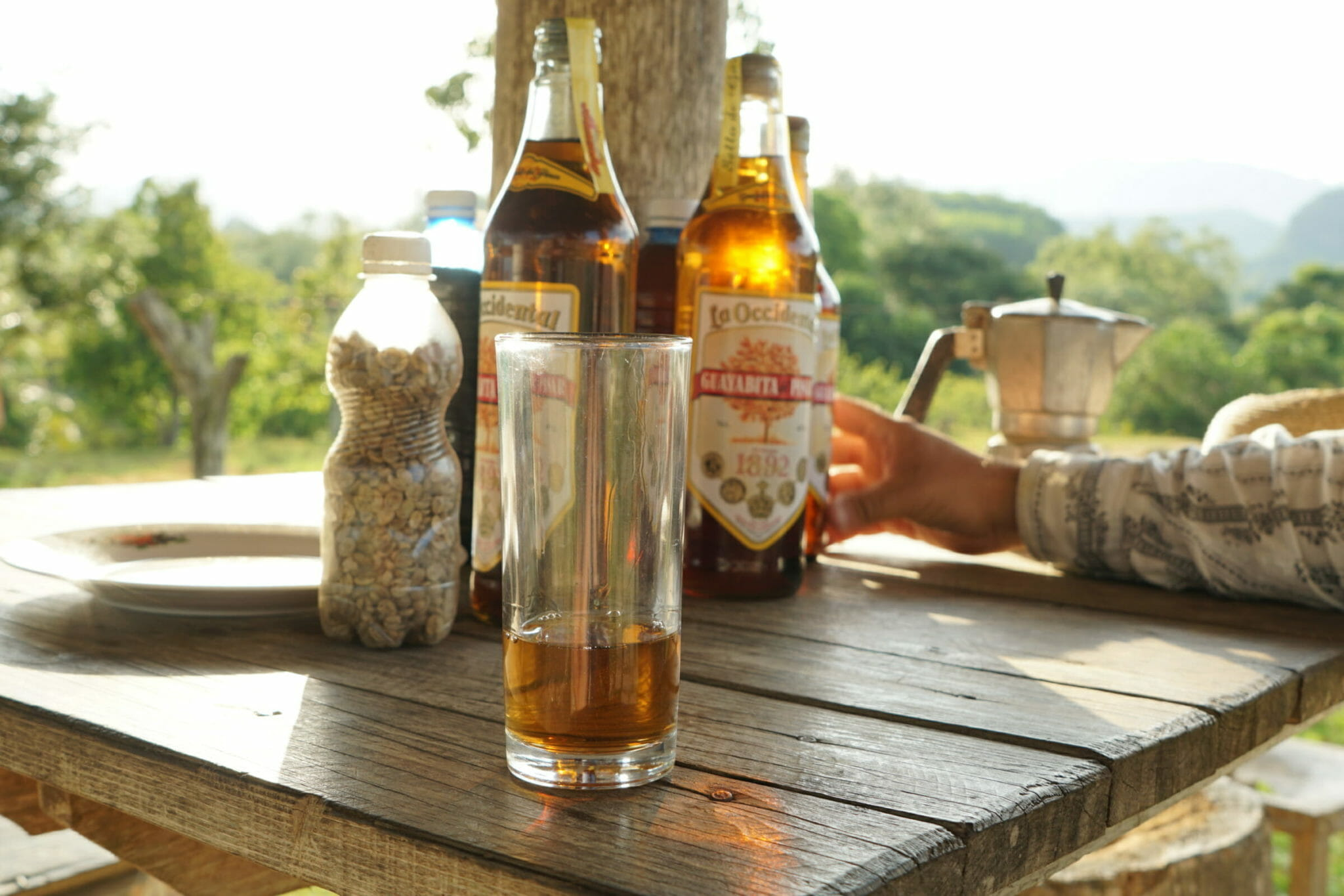 Bottles and glass of rum on table