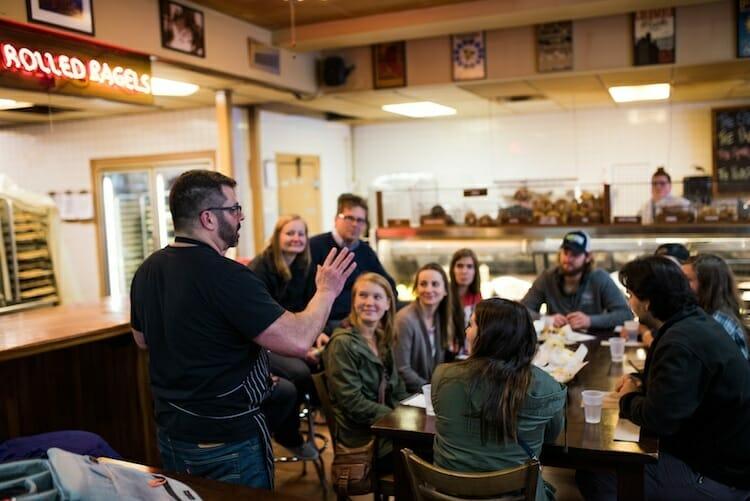 Food tour group at bagel shop