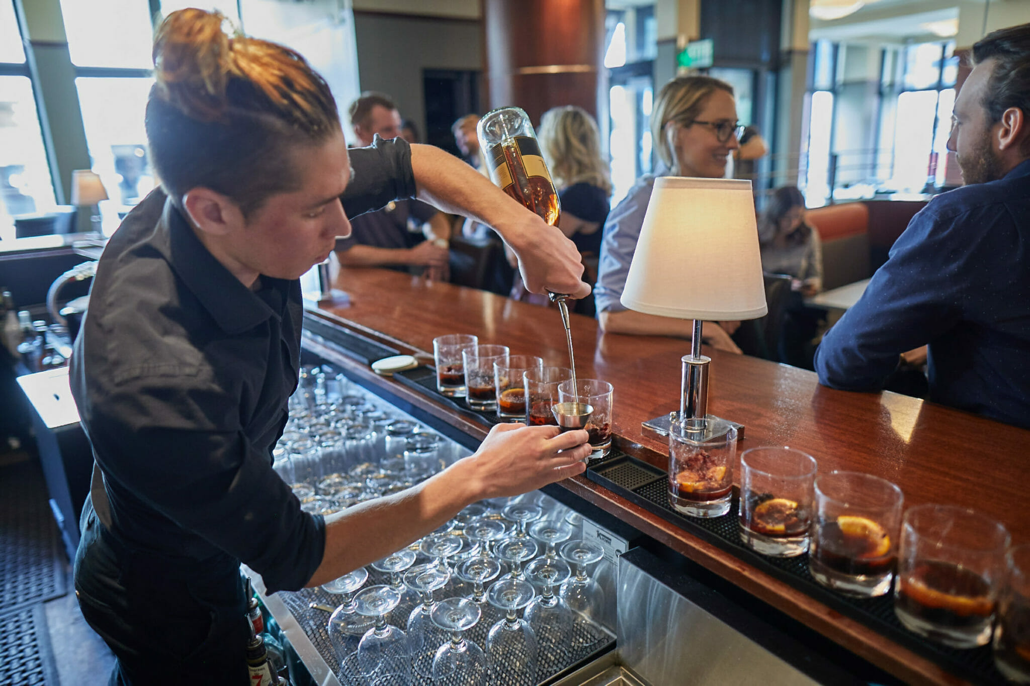 Bartender pouring drinks for Fare & Square food and drink tour