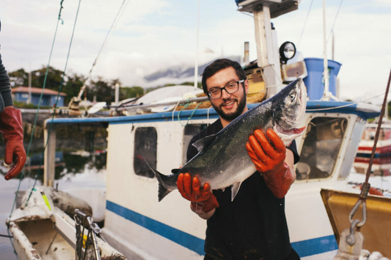 Photo of man holding a fish
