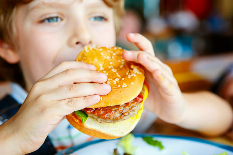 Kid holding hamburger