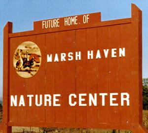 Volunteers in front of Marsh Haven Nature Center sign