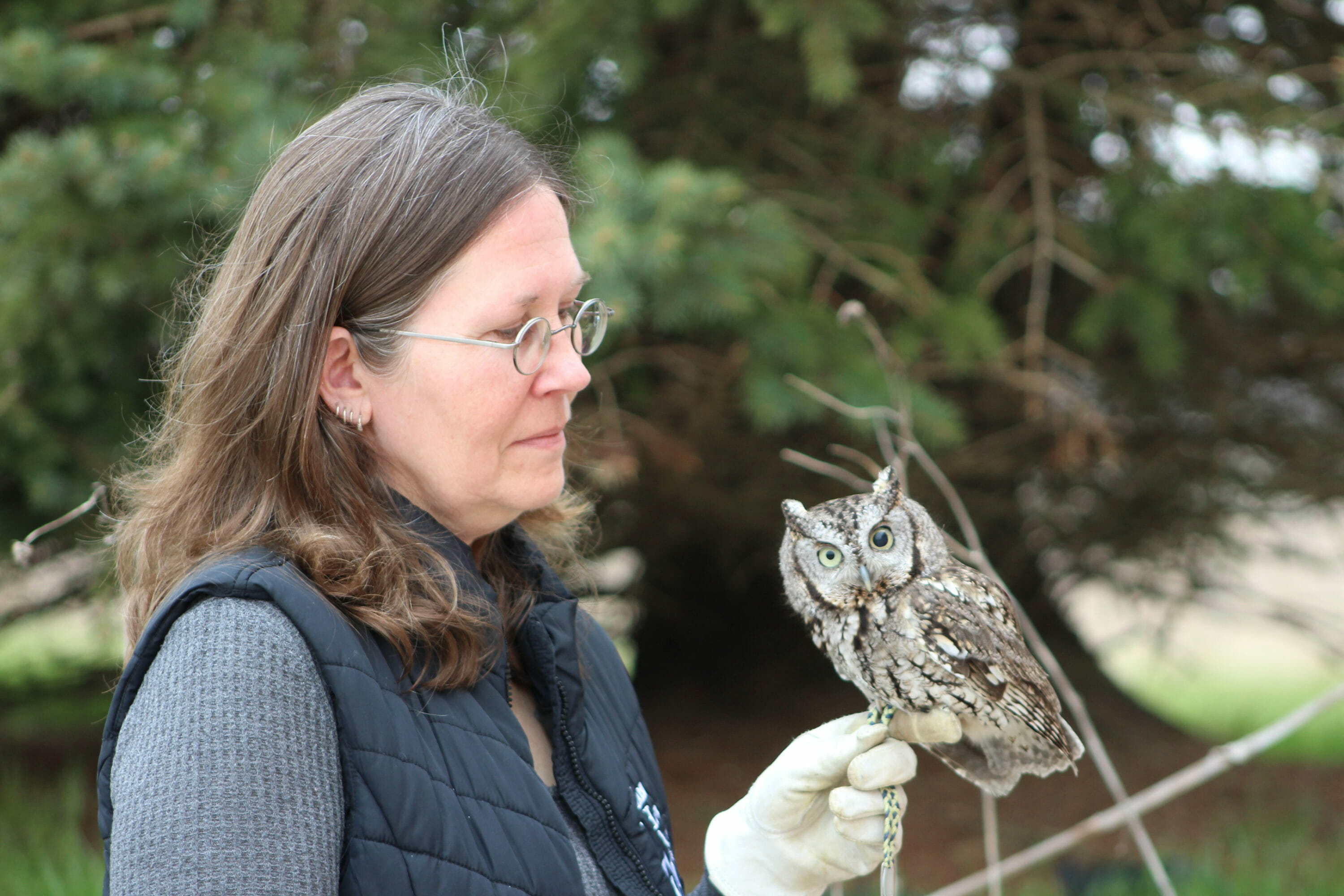 Marsh Haven Instructor with Owl Perched on Hand